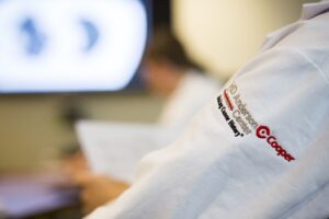 MD Anderson Cancer Center at Cooper logo on white coat sleeve