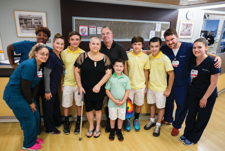 Judith and her family brought gifts to members of the ICU team one month after she was discharged from Cooper.