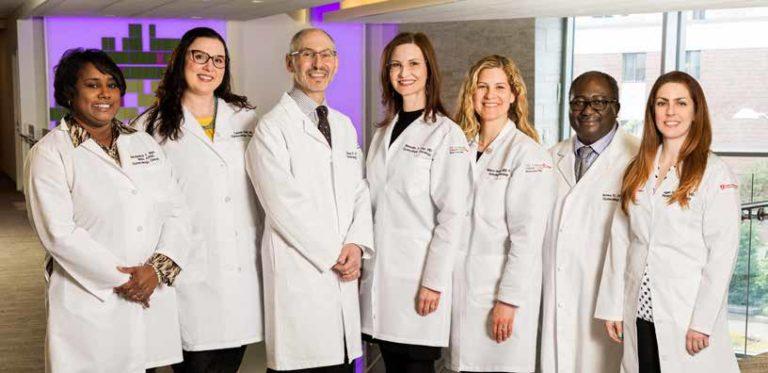 MD Anderson at Cooper's Gynecologic Cancer Team: (L-R) Jacqueline Marzan, APN; Lauren Krill, MD; David P. Warshal, MD; Meredith Crisp Duffy, MD; Rebecca Semanoff, APN; James K. Aikins Jr., MD; and Megan Mezera, MD.