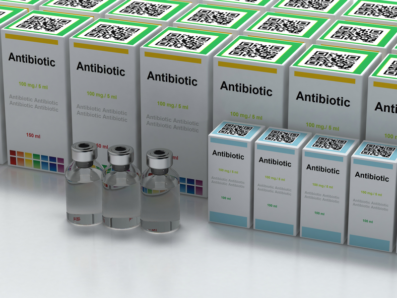Medicine boxes with text antibiotic and vials on white background, 3d render.