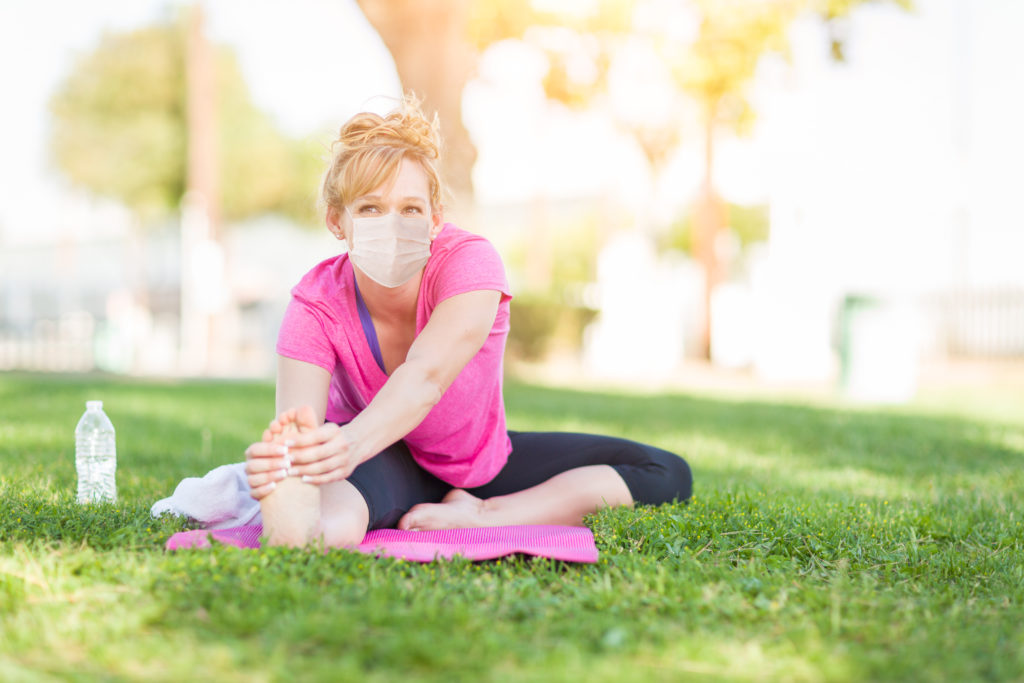 Girl Wearing Medical Face Mask During Workout Outdoors