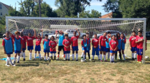 "There's no ""I"" in team! Camden Youth Soccer Club players unite at a recent soccer practice."