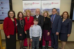 From left: Generosa Grana, MD, director, MD Anderson at Cooper; Adrienne Kirby, PhD, FACHE, president and chief executive officer of Cooper University Health Care; Linda Rohrer, President of the Rohrer Foundation; Ed Warner; Griffin Clarke (front center); Stacey Clarke; Chapman Vail; and Susan Bass Levin, president and chief executive officer of The Cooper Foundation.