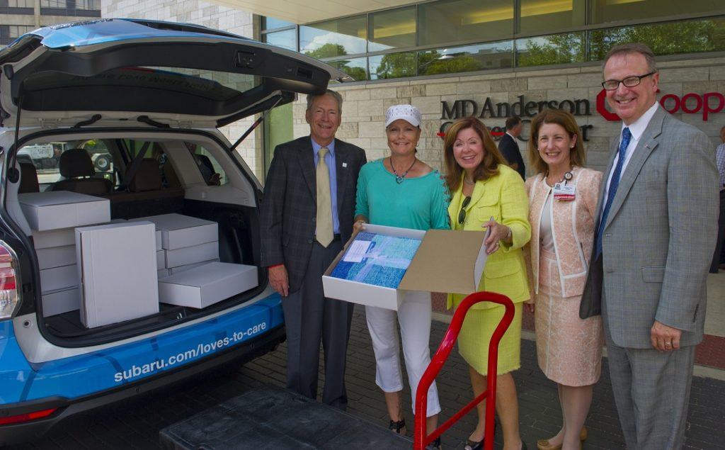 subaru and lls donate blankets to md anderson cooper