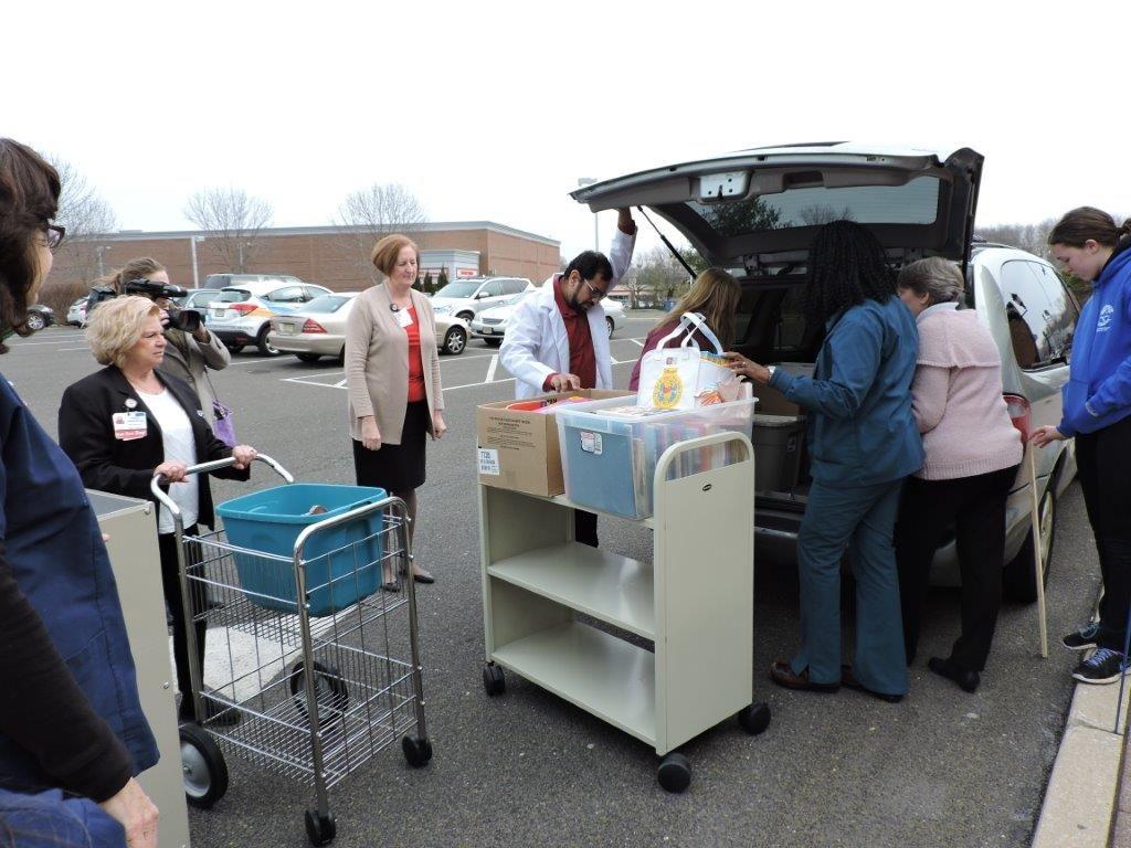 Charlotte Olson donated over 1,000 books to Children's Regional Hospital at Cooper.