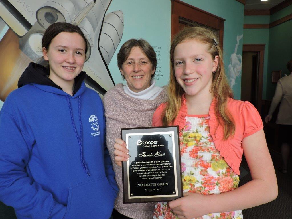 Charlotte Olsen with her sister Emily (left) and mom, Vicki (center).