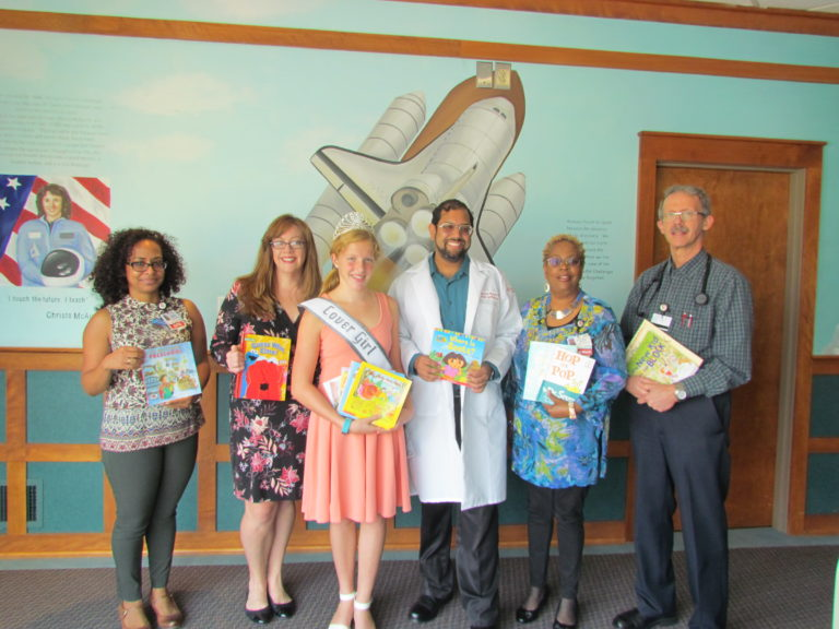 Charlotte Olson (center) once again collected books to benefit young patients at Cooper. Cooper staff was on hand to accept the donation (left to right): Ivette Martinez, APN; social worker Ellen Hearon; social worker Toni Mathis; pediatrician M. Jawaad Hussain, MD, FAAP; and pediatrician Scott L. Kiehlmeier, MD.