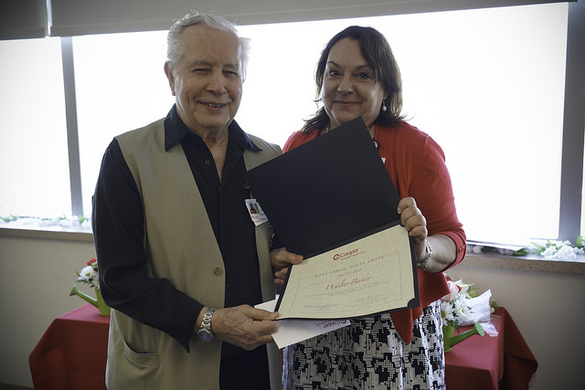 Walter Baker, long-time Cooper volunteer recognized for giving the most service hours, with Kim Santana, Director of Patient Experience at Cooper.