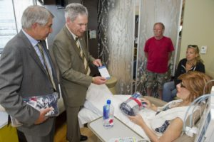 LG and TD give blanket and message to patient