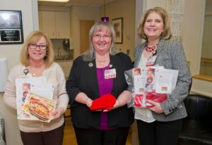 Deborah Schoy, RN, Clinical Director, Mother Infant Unit; Robin L. Perry, MD, FACOG, Chairman and Chief, Department of Obstetrics and Gynecology; and Robyn Harvey, Vice President, Women and Children's Hospital Operations, show-off the items each new mom will receive.