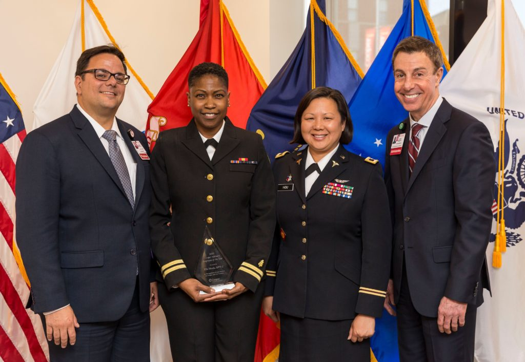 Ella Hawk, APN (second from left) was recognized as 2019 Cooper Military Employee of the Year. Congratulating her on her award (from left to right) are Anthony J. Mazzarelli, MD, JD, MBE, Co-President of Cooper University Health Care; Lisa Hou, DO, Deputy Adjutant General (DAG) for New Jersey; and Louis Bezich, SVP of Strategic Alliances at Cooper.