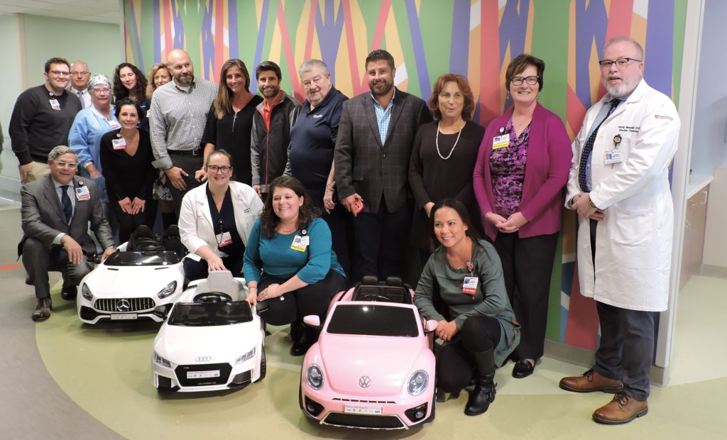 Auto dealers donate mini cars to kids - group shot