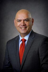 Headshot of Robert A. Ortiz Jr., JD, Senior Vice President and Chief Philanthropy Officer, The Cooper Foundation
