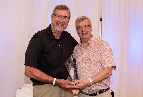 NJHA Board Chair Doug Struyk (right)  presents Dr. Dellinger with his award.